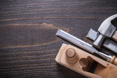 Copy space image of claw hammer planer and firmer. Chisels on vintage wooden board construction concept Stock Image