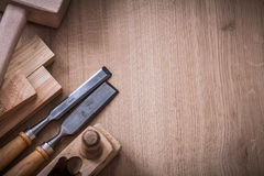 Copy space image of lump hammer planer metal. Firmer chisels and wooden stud on wood board construction concept Stock Photography