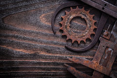 Copy space image of rusted measuring calipers with gear wheel on Stock Images