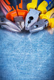 Copy space image of tin snips gripping tongs Stock Images