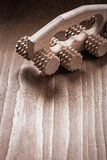 Copy space image of wooden massager on pine Royalty Free Stock Image