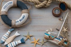 Copy space with lifebuoy, fish, starfish and little boat. Vacation on the sea. Copy space with a lifebuoy, fish, starfish and boat. Vacation on the sea Royalty Free Stock Photography