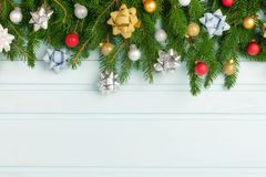 Copy space on light blue background. Christmas arrangement of fir branches decorated with silver, gold and red balls. Holiday layout with space for text royalty free stock images