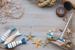 Free Copy Space Of Compass, Fish And Boat. Marine Life. Vacation On The Sea Stock Photography - 117640822