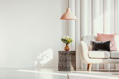 Free Copy Space On White Wall Of Elegant Living Room With White Flowers On Glass Vase On Stylish Table Next To White Sofa Royalty Free Stock Photography - 162175887