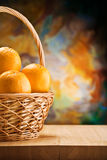 Copy space oranges in wicker bast royalty free stock photos
