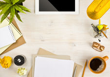 Copy space, paper, stationery and tablet computer on wooden background Stock Images