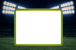 Copy space for soccer game. Empty white board with copy space for world cup 2014 with soccer stadium in the background Royalty Free Stock Photos