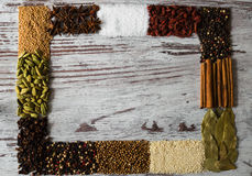 Copy space of spices frame. Black pepper, cardamom, coriander, mustard seeds, bay leaf, cinnamon. Royalty Free Stock Photos