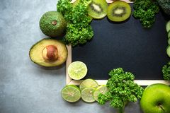 Copy space text on the board table. Diet for the healthy body and detox with fresh green fruits. And vegetable. Healthy Concept stock photo