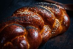Fresh homemade bun with poppy seeds, with ingridients on dark rustik background. royalty free stock photo