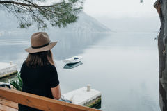Copy space. Travel woman in a hat enjoys a view of the bay in Mo Royalty Free Stock Photos