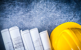 Copy space version of white rolled blueprints and royalty free stock images