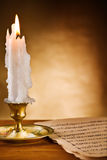 Copy space view on the ablaze candle and old notes royalty free stock photography