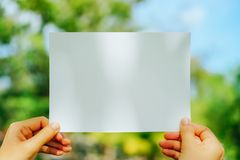 Copy space of white paper on nature background. royalty free stock photography