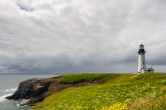 Copy space Yaquina Head Lighthouse under cloudy skies Royalty Free Stock Photography