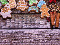 Copy spice of Christmas cookies on wooden table. Stock Image