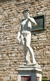 A copy of the statue of David by Michelangelo, in the background of the Palazzo Vecchio in Piazza della Signoria in Florence Stock Image