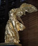 Gilded Winged Victory of Samothrace in Chicago. A copy of Winged Victory of Samothrace is on display in the lobby at the Bank One Center in downtown Chicago Royalty Free Stock Photos