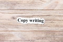Copy writing of the word on paper. concept. Words of Copy writing on a wooden background Royalty Free Stock Photography