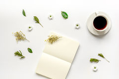 Copybook, americano and flowers on white table top view mock-up Stock Images