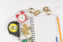 Copybook with drawings and fittings Royalty Free Stock Photography