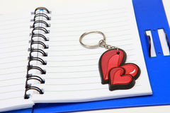 A copybook and a key ring Royalty Free Stock Photo