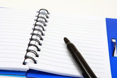 A copybook and a pen Stock Photography