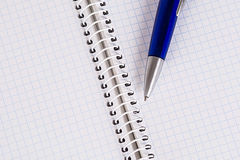 Copybook and a pen Stock Image