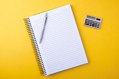 Copybook, pen and calculator Royalty Free Stock Images