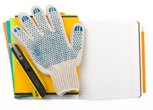 Copybooks with gloves Royalty Free Stock Image