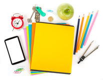 Copybooks with smartphone and office stuff Stock Images