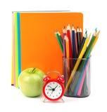 Copybooks z świeżym jabłkiem i budzikiem Obraz Royalty Free