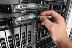 Copying Data from the server. Using a USB memory stick to copy files from rack mounted servers in a data center Stock Photo