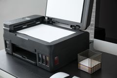 Copying machine with document in office, Royalty Free Stock Photos