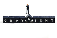 Copyright. A man standing behind the word copyright Stock Images
