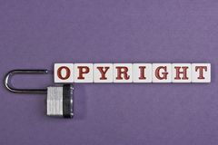 Copyright. Word copyright on a purple background with a lock representing letter C Royalty Free Stock Photography