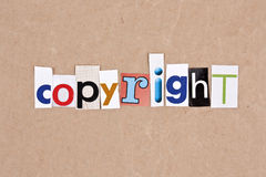 Copyright. Letters sorted on paper background Stock Images