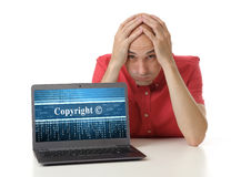 Copyright concept. Frustrated man with laptop. Copyright concept Royalty Free Stock Photo