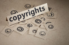 Copyright concept symbol. Word copyright with many symbols around written on paper Stock Image
