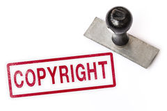 Copyright copyleft text label stamp for documents. Copyright copyleft red text sign label stamp with stamper isolated white paper background documents stock photography