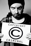 Copyright criminal. Man arrested for violating copyright laws Royalty Free Stock Image