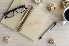 Copyright document folder and desk office. Concept of copyright stock photography