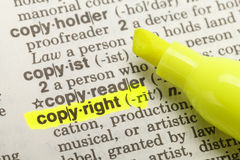 Copyright Highlight. Yellow Highlighter And Marked Copyright Dictionary Royalty Free Stock Photography