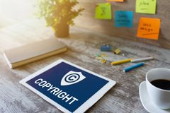Copyright icon on screen. Patent Law and Intellectual Property. Business, Internet and Technology Concept. stock photography