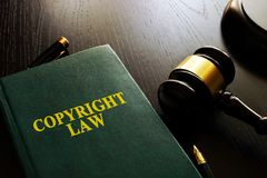 Copyright law and gavel. stock photos
