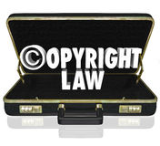 Copyright Law Legal Court Case Attorney Lawyer Suit C Symbol. Copyright Law words and c symbol in 3d letters in a black leather briefcase of an attorney or Stock Images