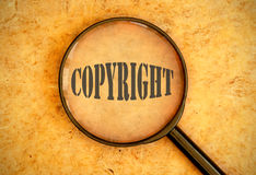 Copyright. Magnifying glass focused on the word copyright Stock Images