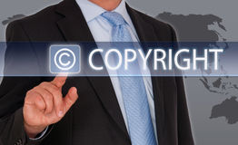 Copyright - Manager with touchscreen and text Stock Photography