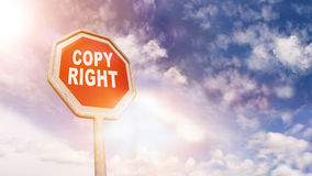 Copyright on red traffic road stop sign Stock Photos